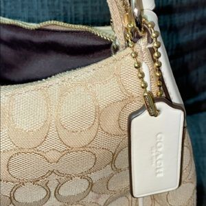 Cream colored Coach purse